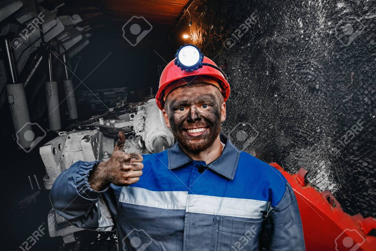 Portrait working young male miner in red cap showing thumbs up, excellent sign background coal mine. Industrial concept - 132319616
