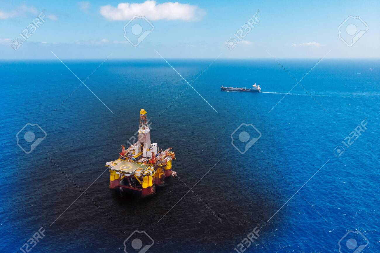 Oil rig accident spill into sea, aerial top view. Concept ecological disasters water - 133397380