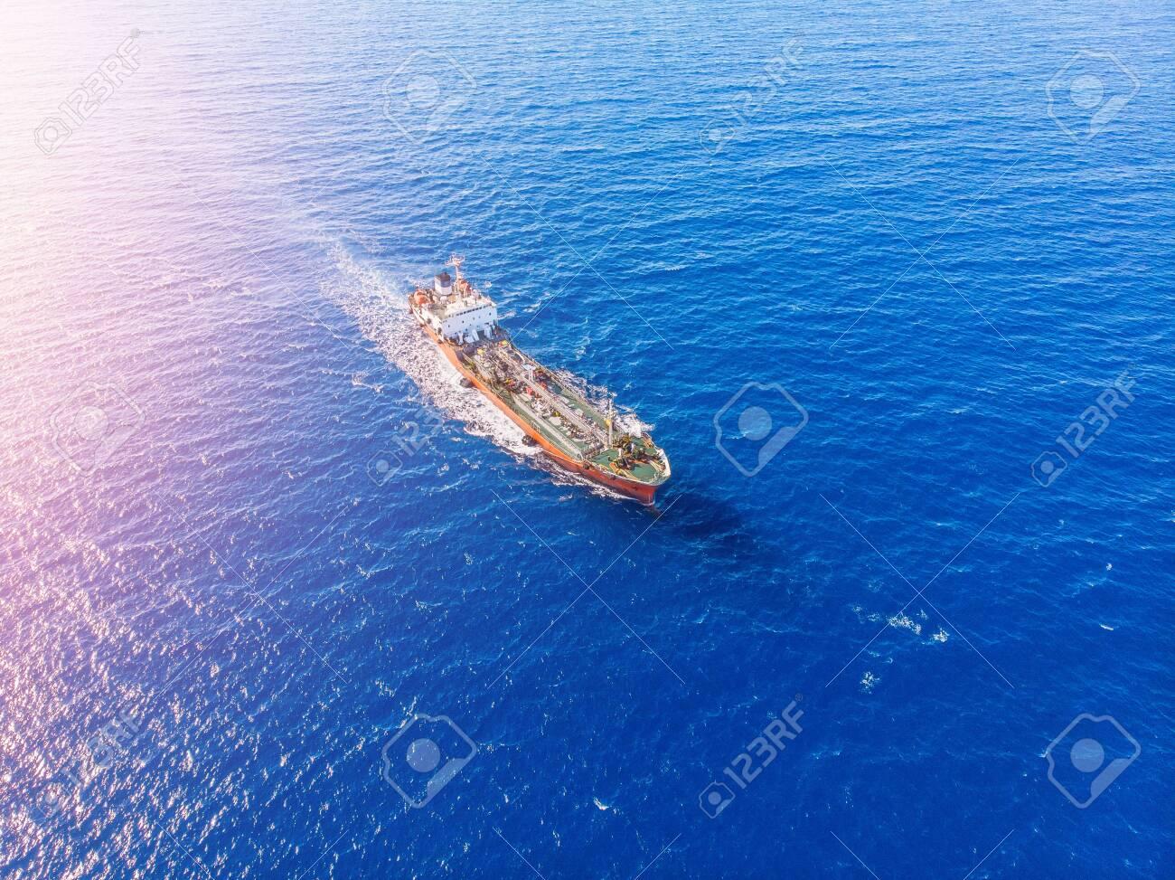 Oil chemical tanker sails blue sea. Aerial top view - 133397384