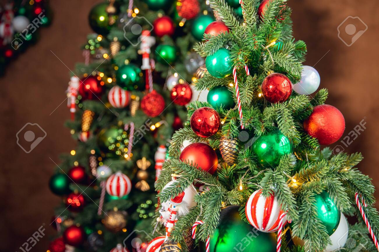 Decorated Christmas Tree Red And Green Color Close Up Of Toys Stock Photo Picture And Royalty Free Image Image 138471470