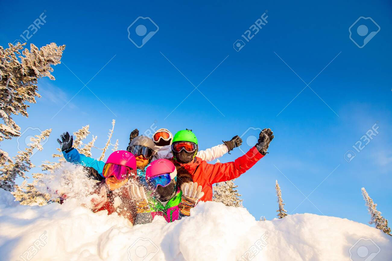 Group of happy friends having fun in winter forest. Snowbarders and skiers group team friendship ski resort. - 140465153
