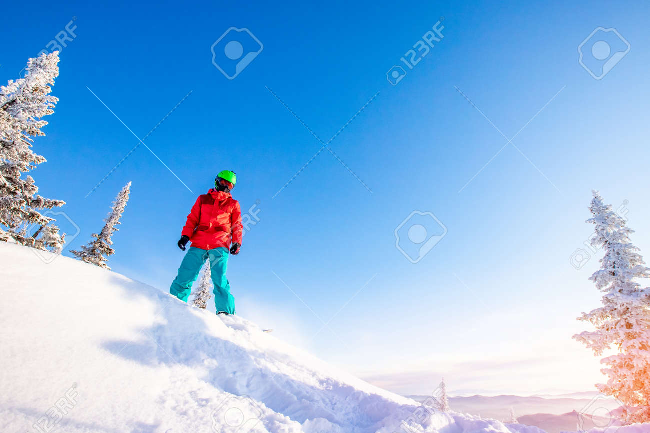 Snowboarder jumping through air with deep blue sky in background, Freeride winter forest - 155047720