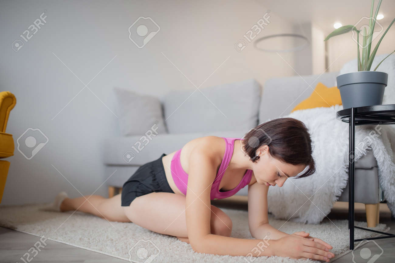 Girl training home fitness practices relaxation yoga indoor. Concept sport lifestyle - 166055626