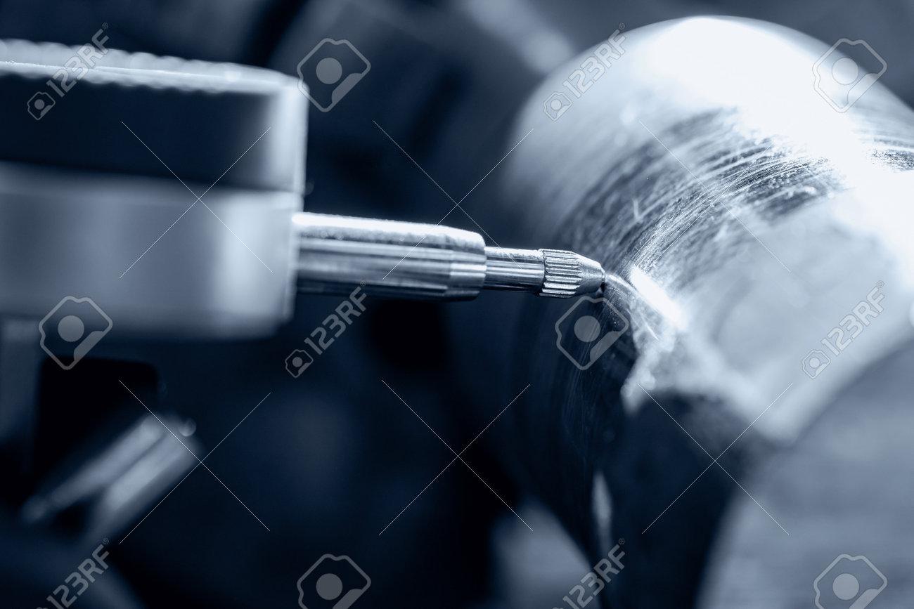 Process CNC lathe machine cutting metal. Operator measures vibration of workpiece steel ingots - 170719163