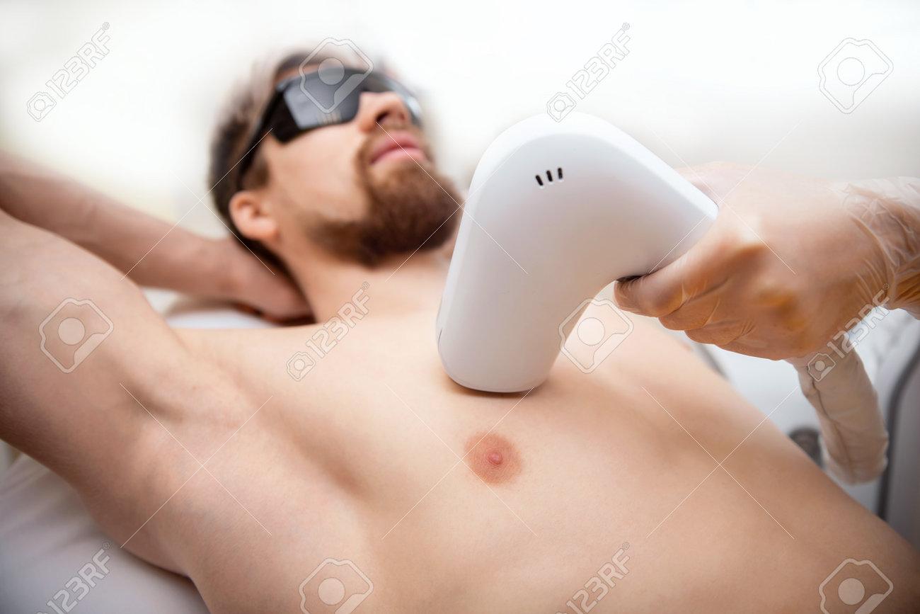 Man torso under treatment in hair removal laser epilation studio - 170719285