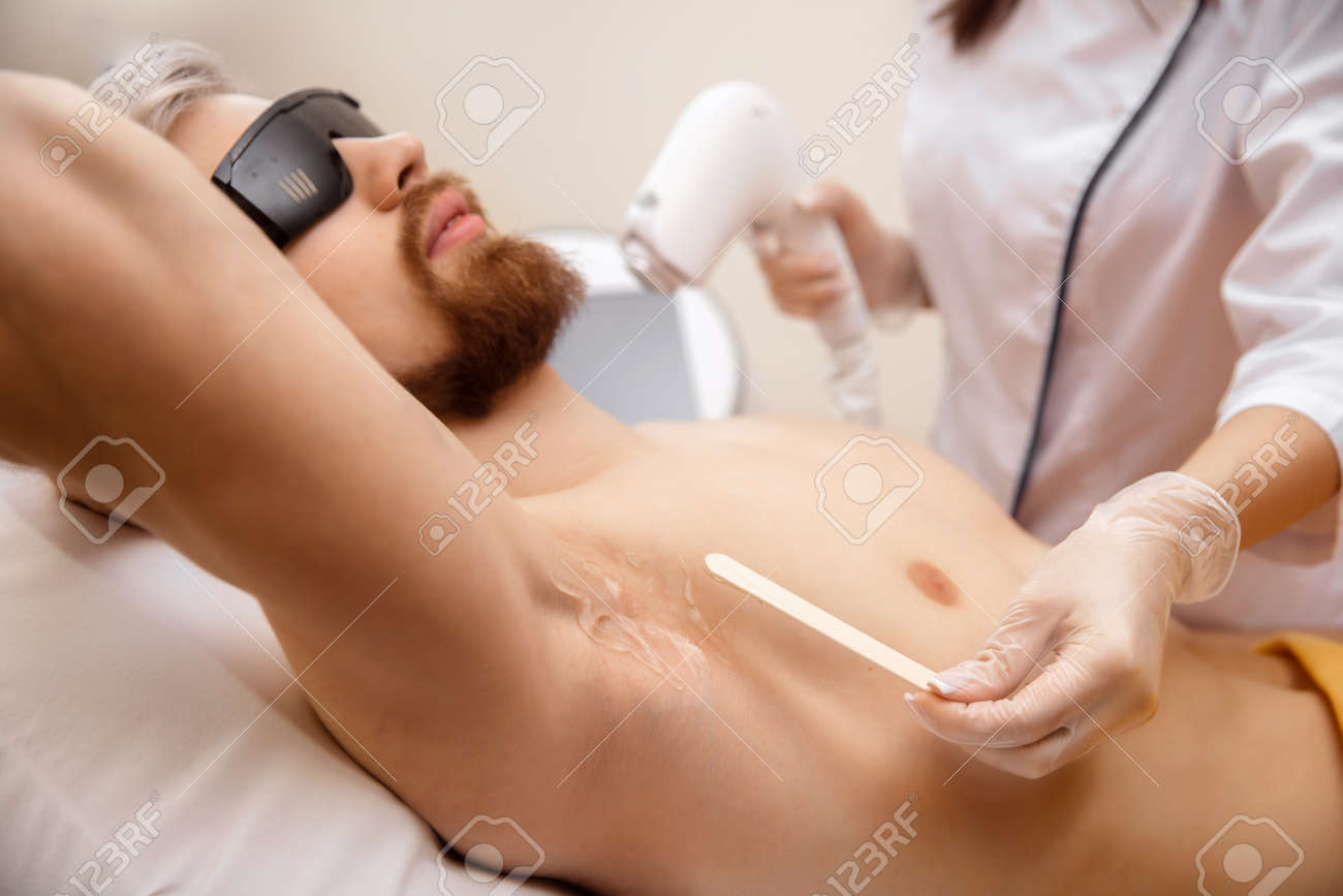 Closeup hair removal procedure from men armpit, laser epilation studio - 170719288