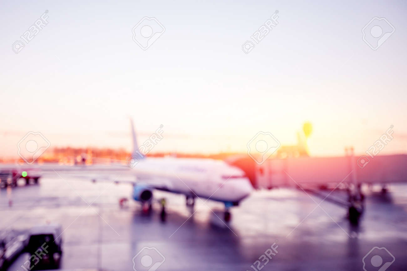 Abstract Blur background of airplane airport against sun light waiting for passengers - 166138190