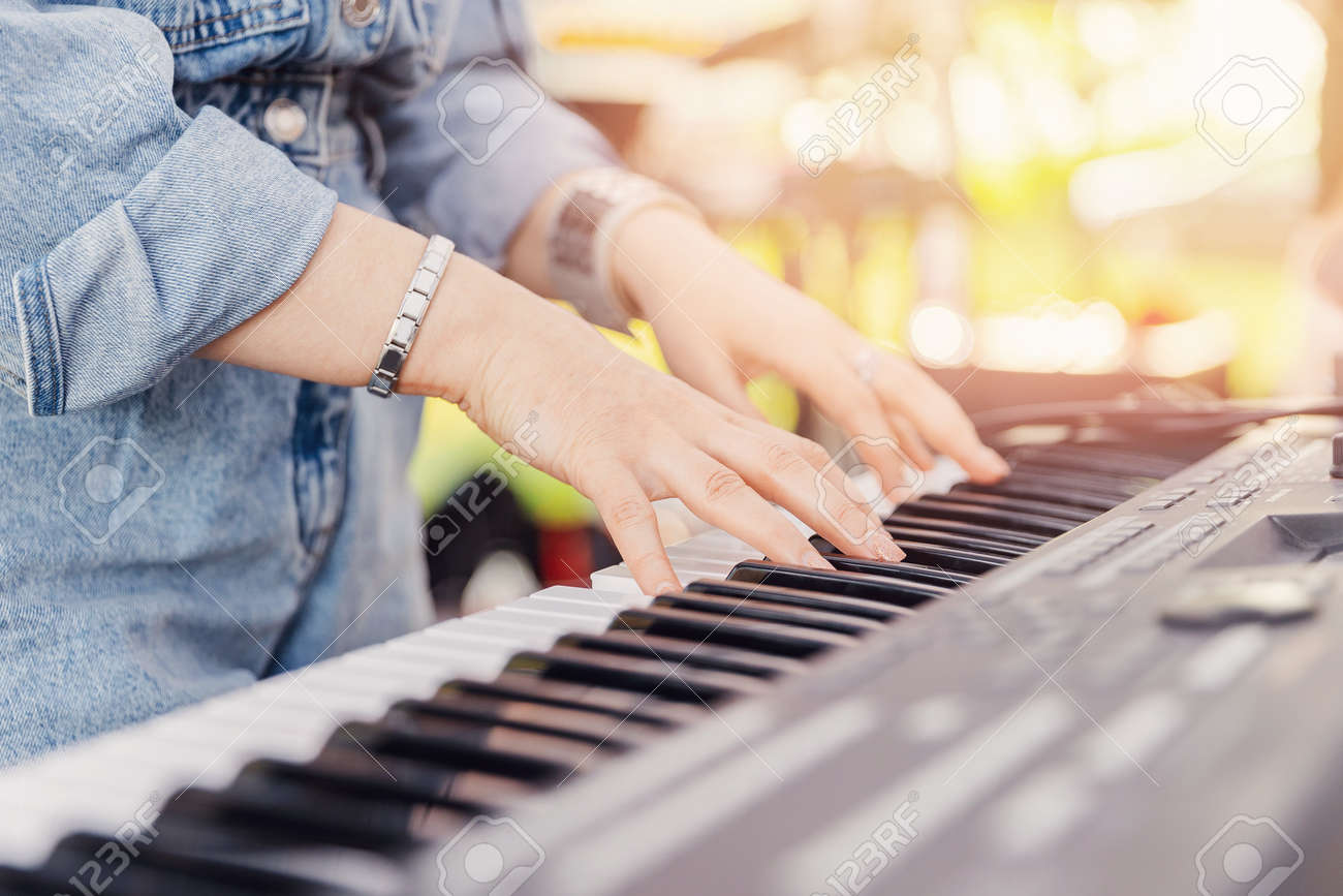 Closeup of thumbs up street musician woman playing on mobile piano - 172921619