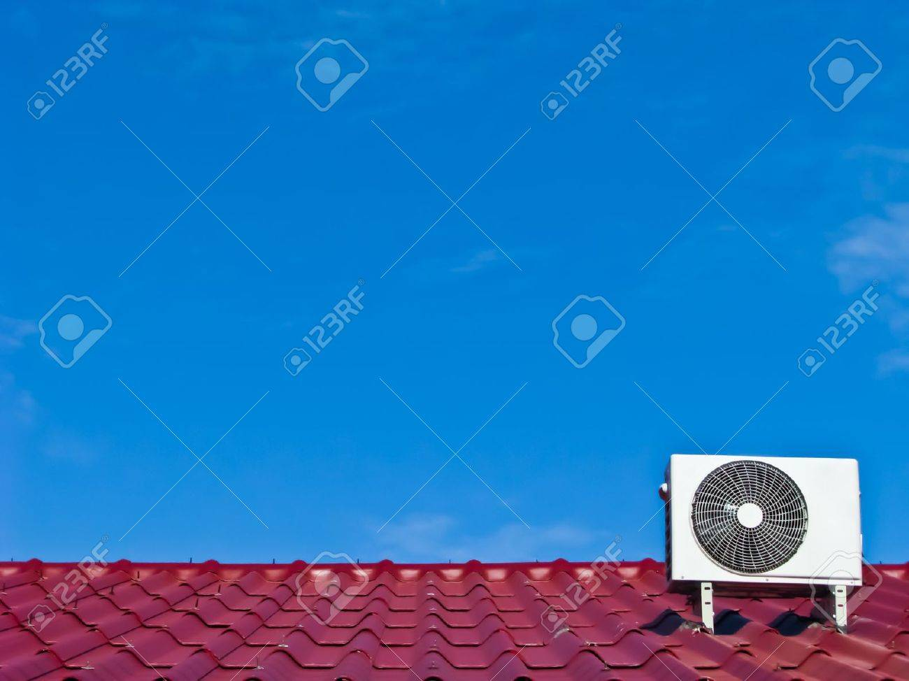 air conditioner 's compressor on the red roof Stock Photo - 10018787