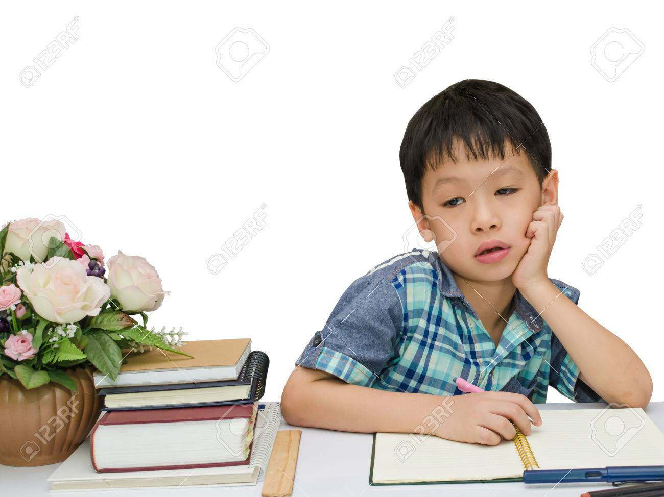 Asian schoolboy doing his homework on white background Stock Photo - 29276952