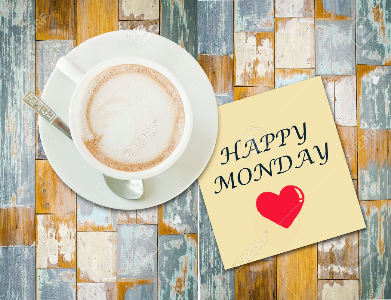 Coffee cup on wood table with paper note and message  Happy Monday Stock Photo - 29747865