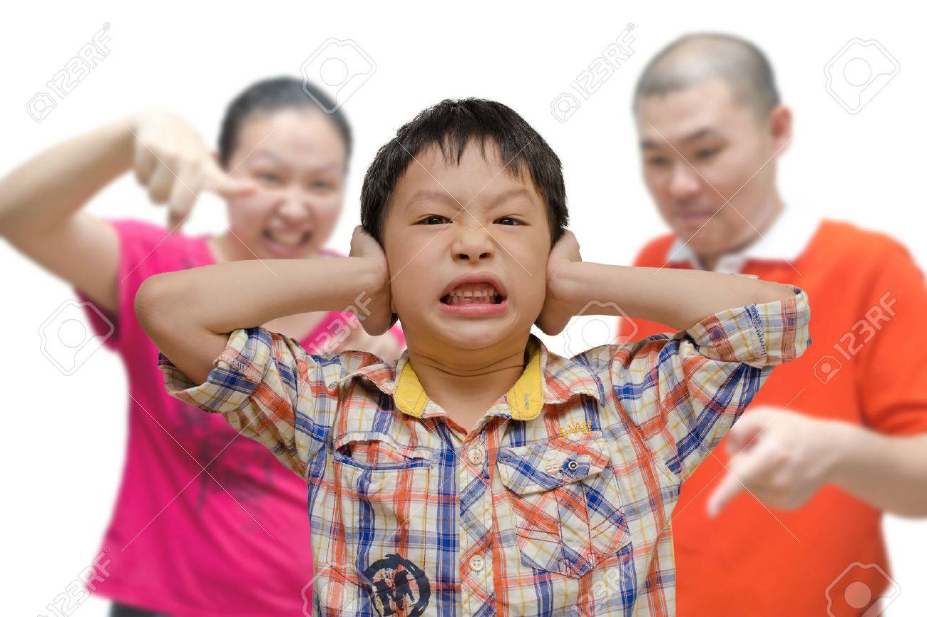 Young Asian Boy Being Scolded by Parents Stock Photo - 30136368