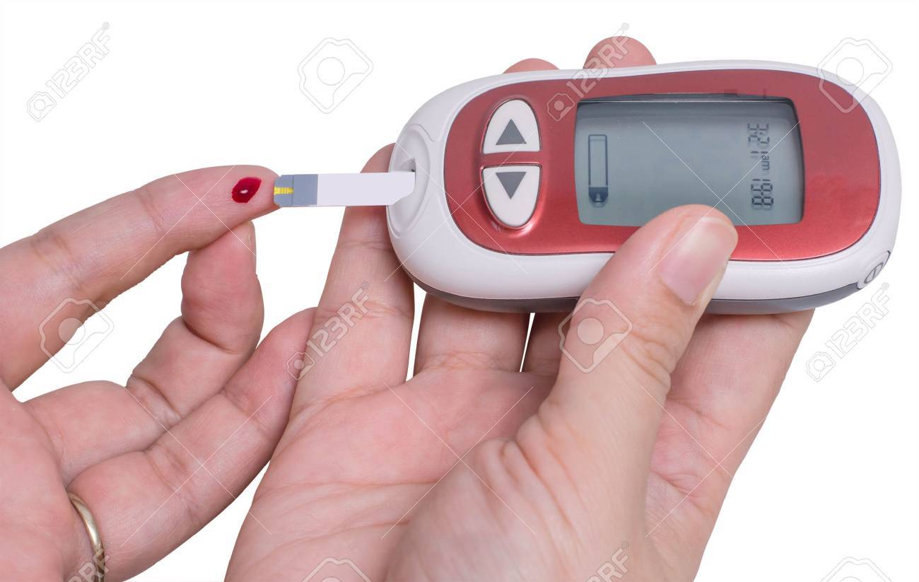 Checking the glucose level with a glucometer Stock Photo - 31095232