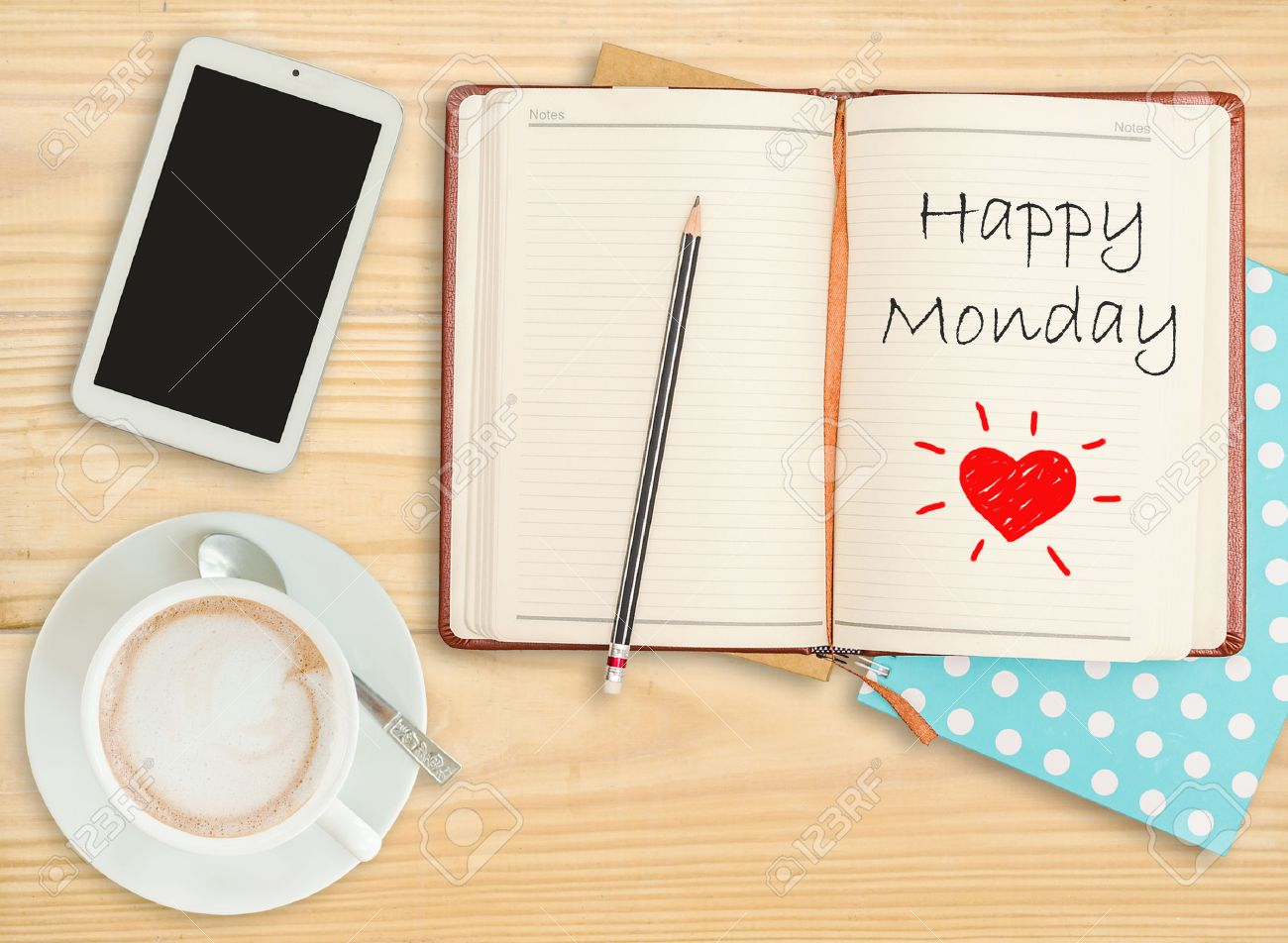 Happy Monday on notebook with pencil, smart phone and coffee cup Stock Photo - 31794483