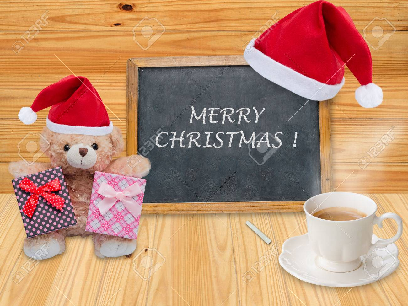 Merry Christmas On Chalkboard With Christmas Hat And Coffee Cup ...