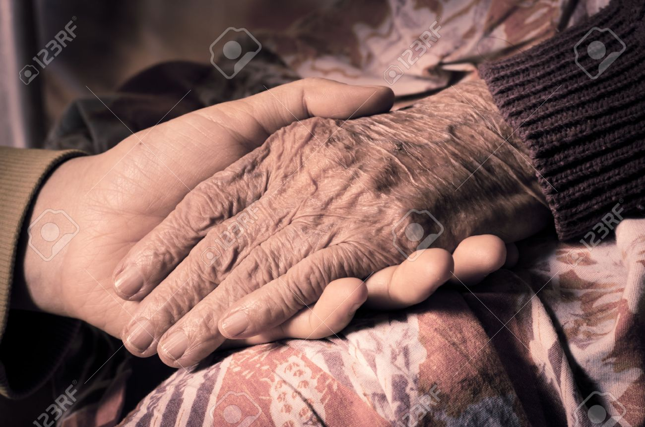 Young girl hand touch her grandma hand Stock Photo - 35174442