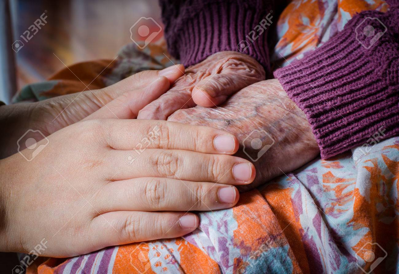 Young girl hand touch her grandma hand Stock Photo - 35174445