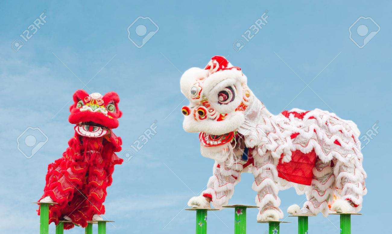 Chinese lion costume dance during Chinese New Year celebration Stock Photo - 36231965