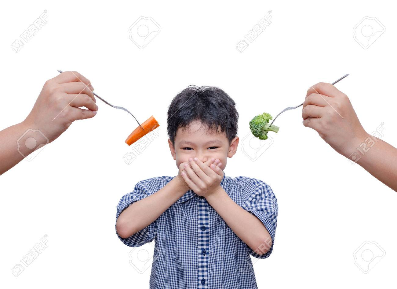 Asian boy close his mouth by hands because don't want to eat vegetables Stock Photo - 51896413