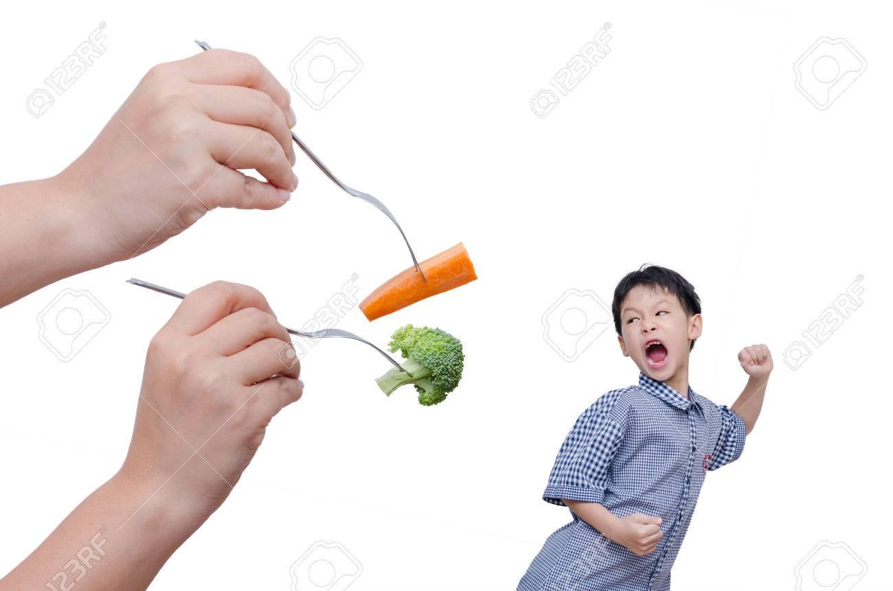 Little Asian boy run away from eating vegetables over white Stock Photo - 44188602