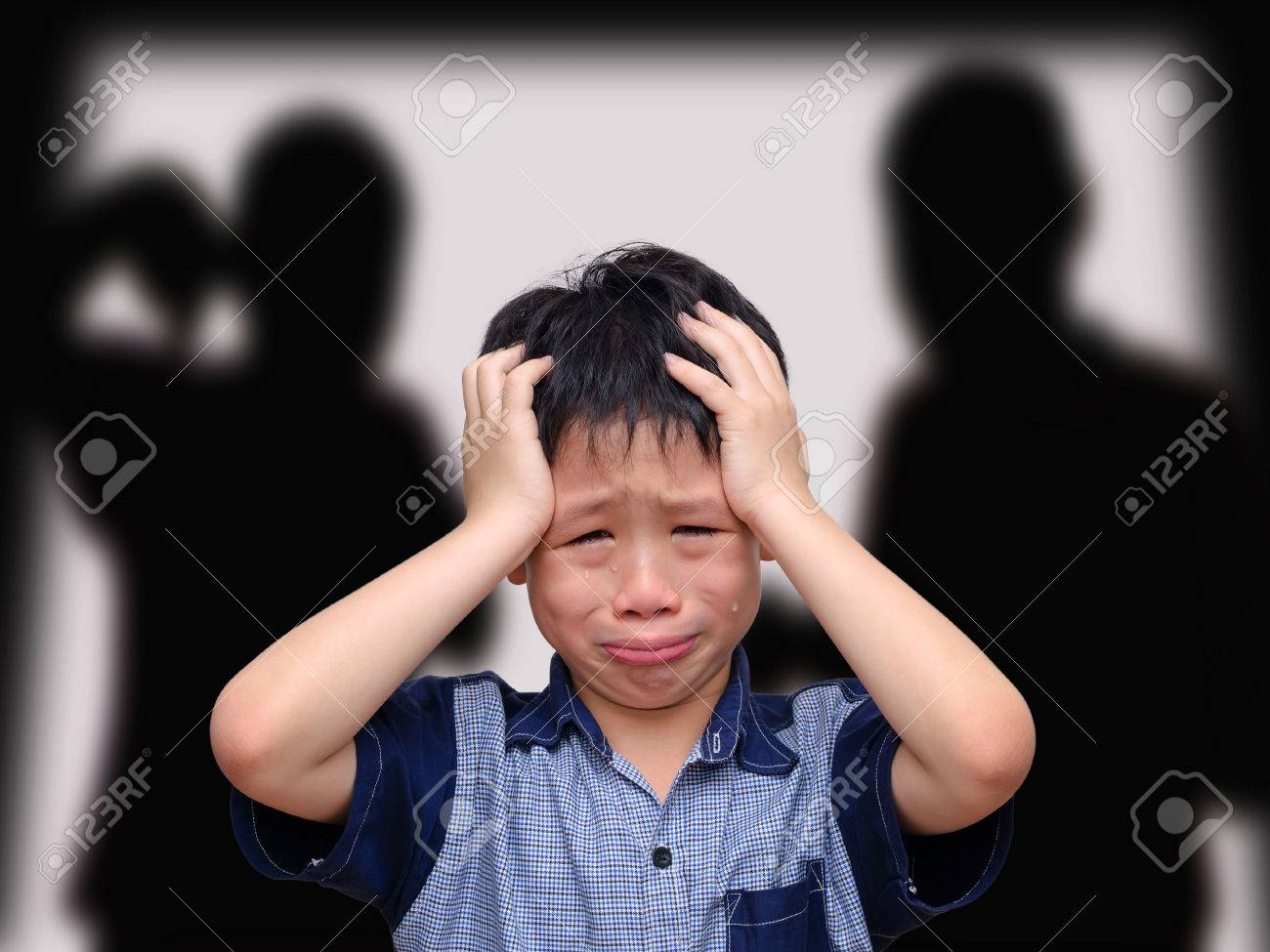 Crying asian boy with his fighting parents in the background Stock Photo - 44185207