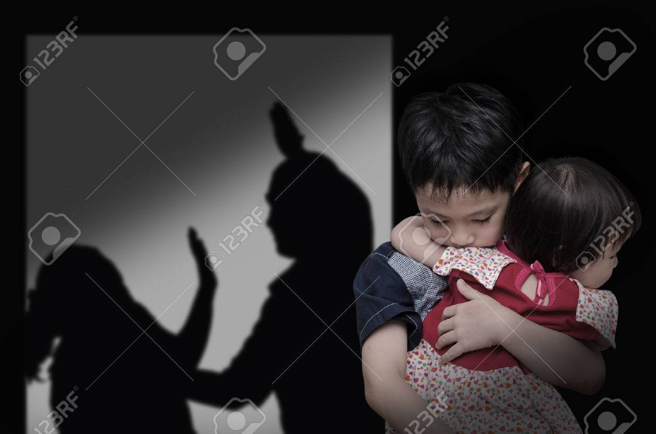 Asian child with his parent fighting in background - 53135419
