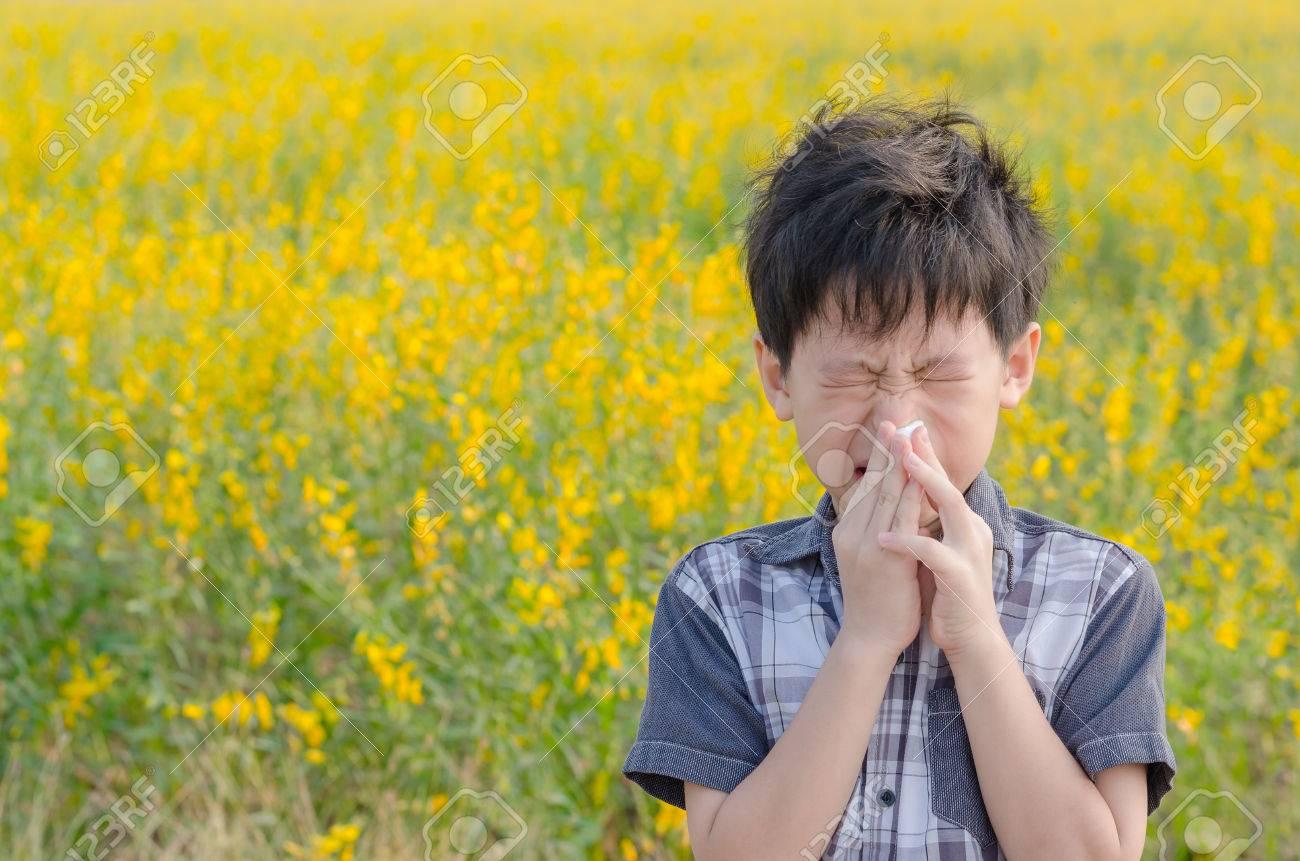 Little Asian boy has allergies from flower pollen - 56771629
