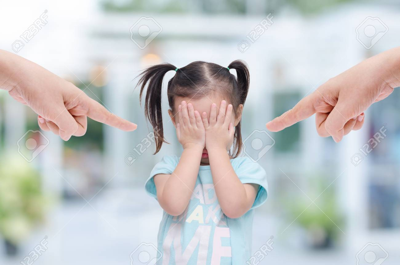 Little asian girl crying while parents scold her - 61321324