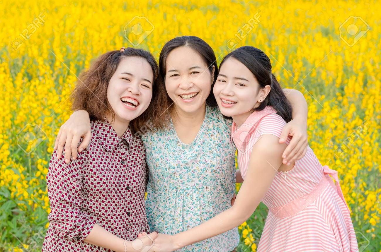 Asian mother and her daughter at flower field - 63839571