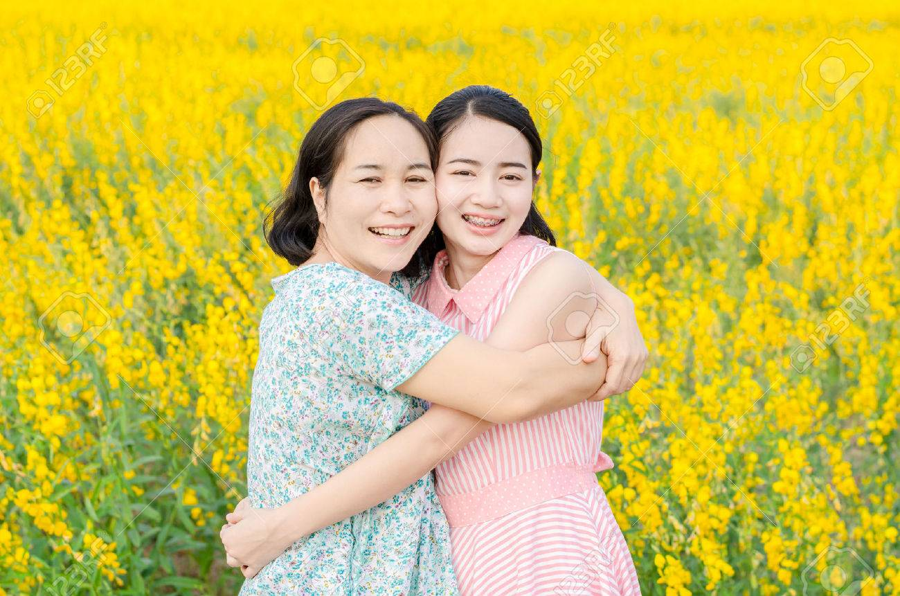 Asian mother and her daughter at flower field - 63839583