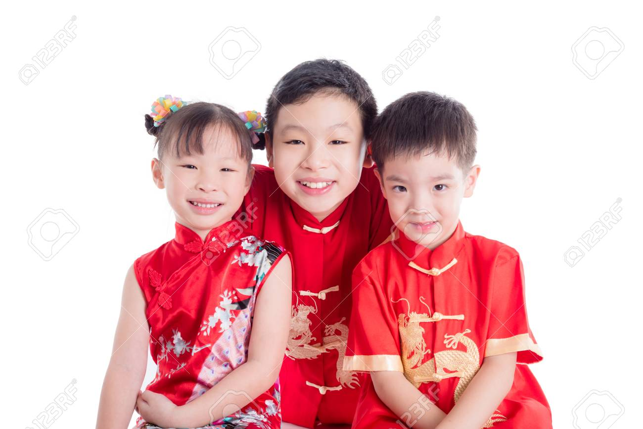 335732f29 Group of chinese children wearing traditional costume smile at camera over  white background Stock Photo -