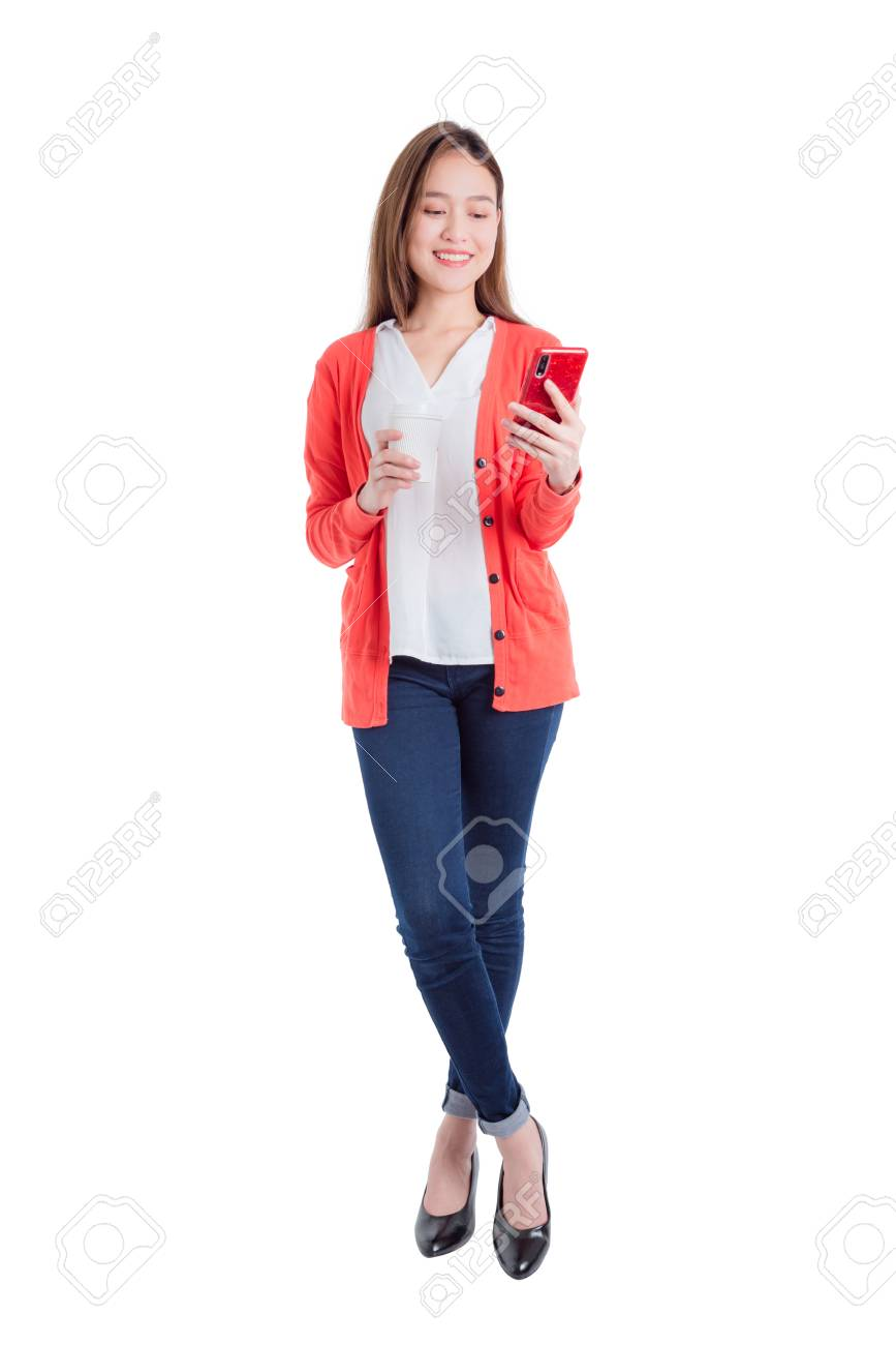 Full length of beautiful asian woman holding smart phone and coffee cup isolated over white background - 123954352