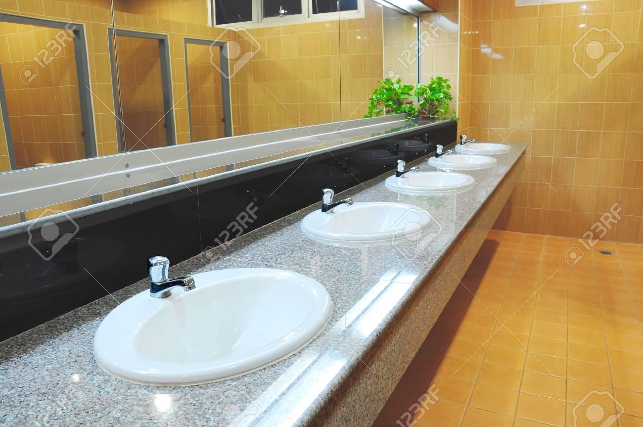 Handbasin and mirror in toilet Stock Photo - 8817718