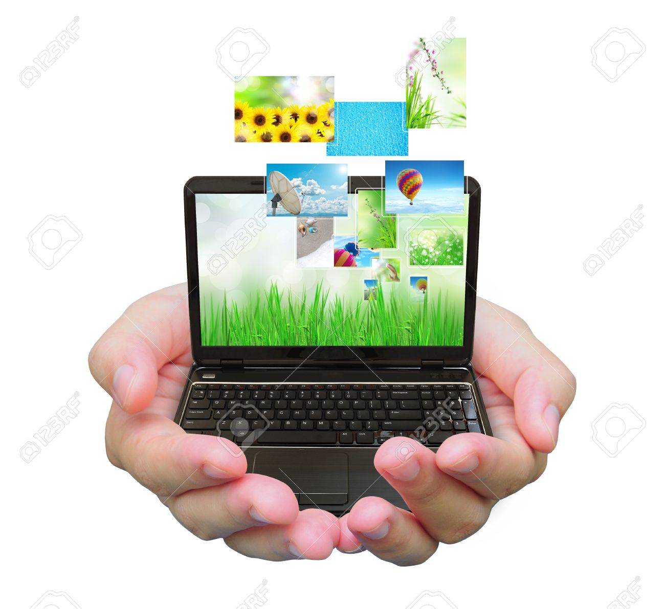 laptop PC and streaming images virtual buttons on women hand Stock Photo - 11919454