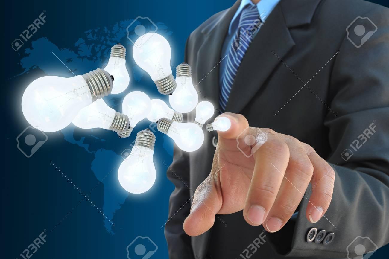 businessman hand holding light bulb Stock Photo - 13224259