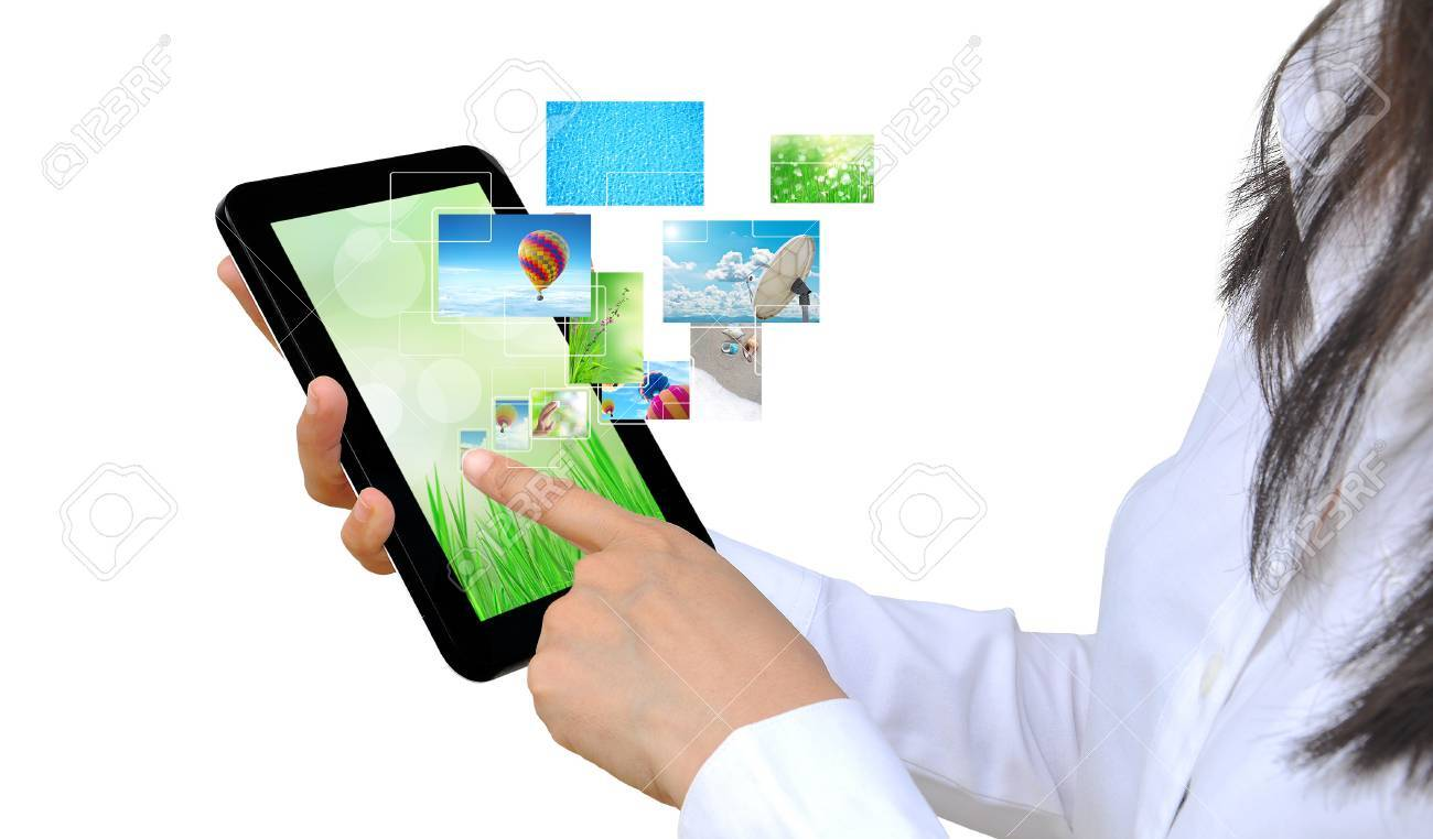 touch pad PC and streaming images virtual buttons on women hand Stock Photo - 15194092