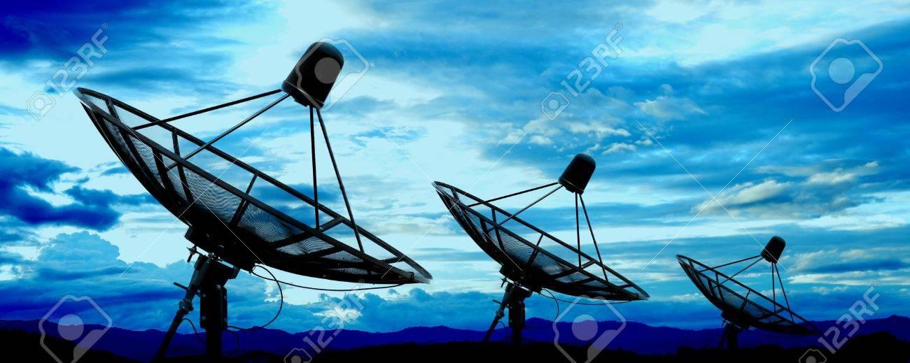 satellite dish antennas under blue sky - 16296571