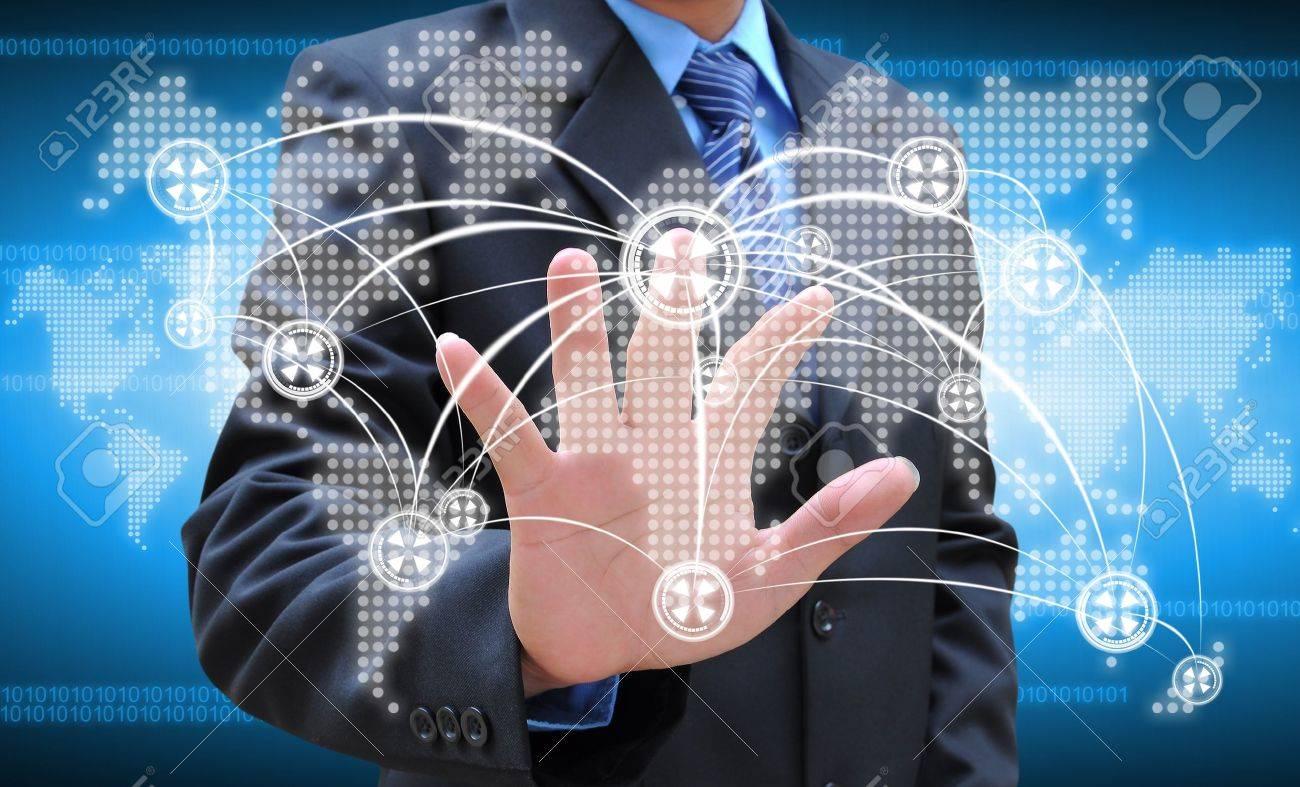 businessman hand pushing social network on world map - 16573105