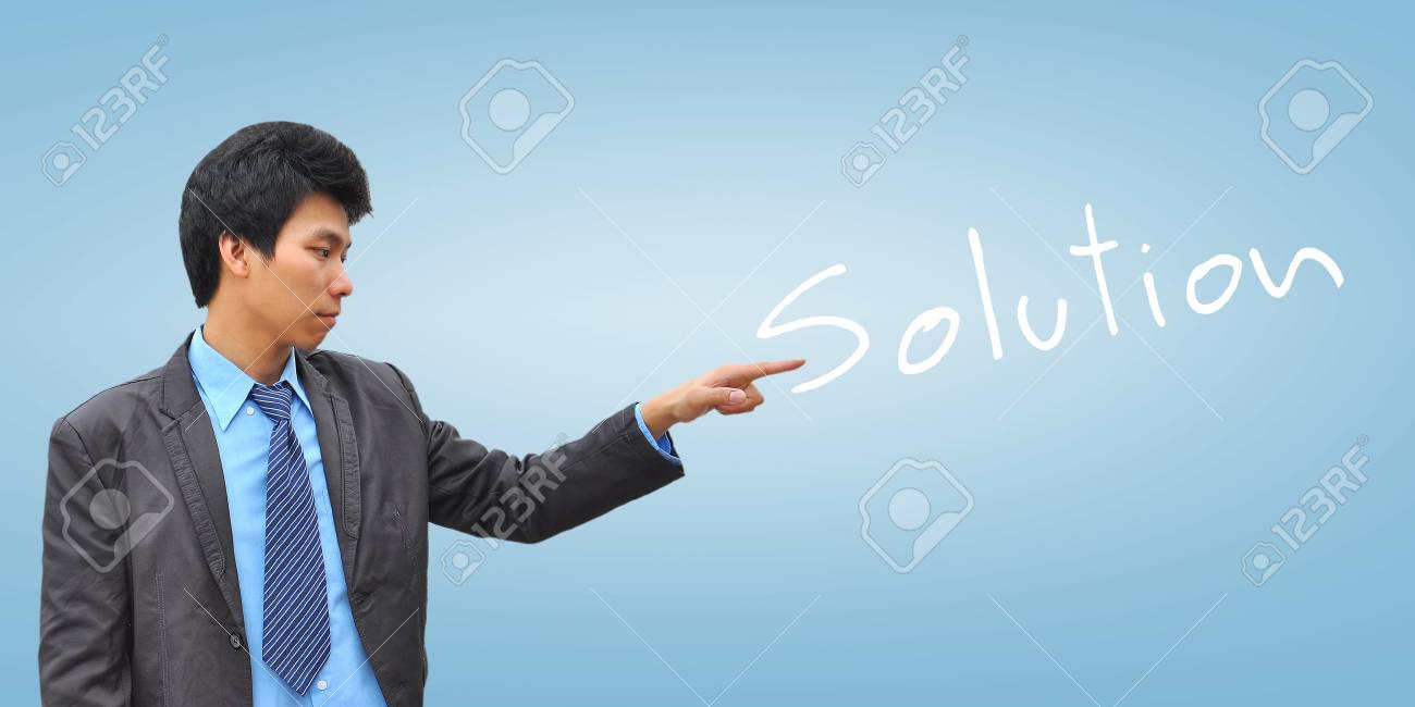 businessman hand pushing solution Stock Photo - 18348855