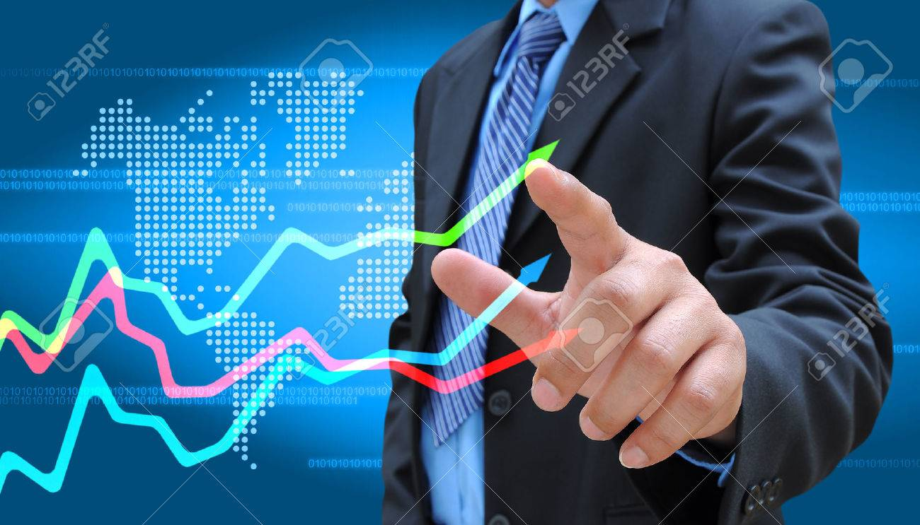 businessman hand pushing a business graph - 23129075