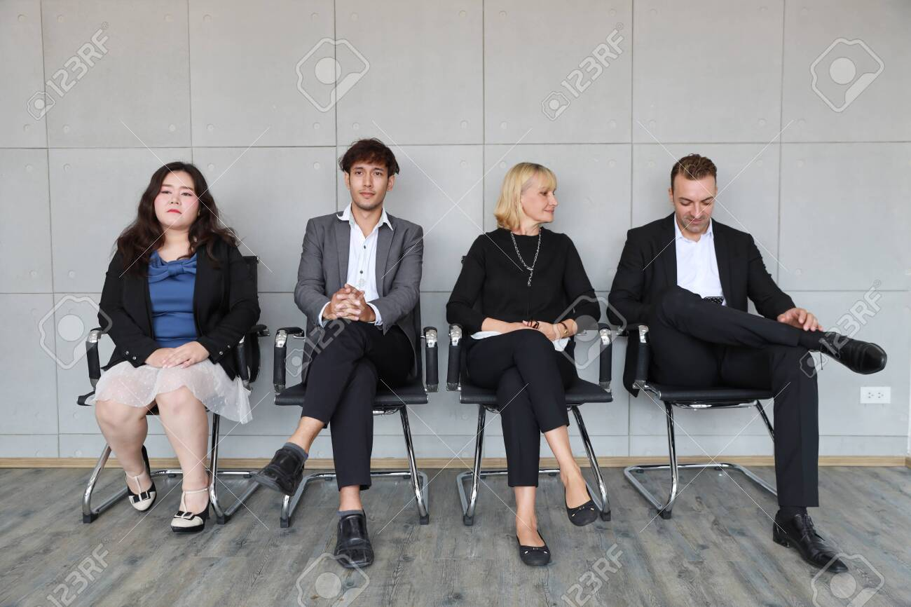 portrait of multiethnic business people in working dress who sitting and line up for HR interview - 130785769