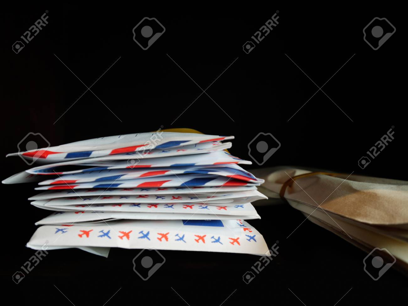 Letters And Documents Stack In Wooden Bookshelf Stock Photo