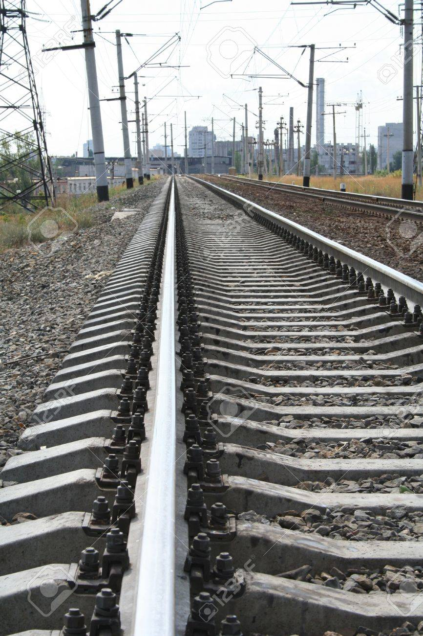 Background image rails - Railroad Tracks Rails Cross Ties Rubble And Wires On A Background Of City