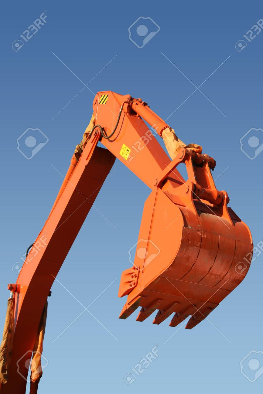 Hand and shovel bucket on a background of the blue sky, Isolated (look similar images in my portfolio) Stock Photo - 634147