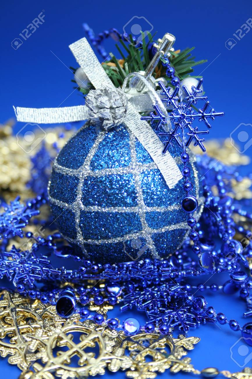 Christmas sphere of dark blue color with a pattern and a celebratory beads Stock Photo - 673446