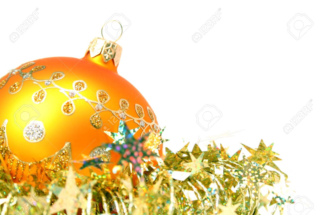 Christmas sphere of yellow color and celebratory tinsel on a white background Stock Photo - 897494