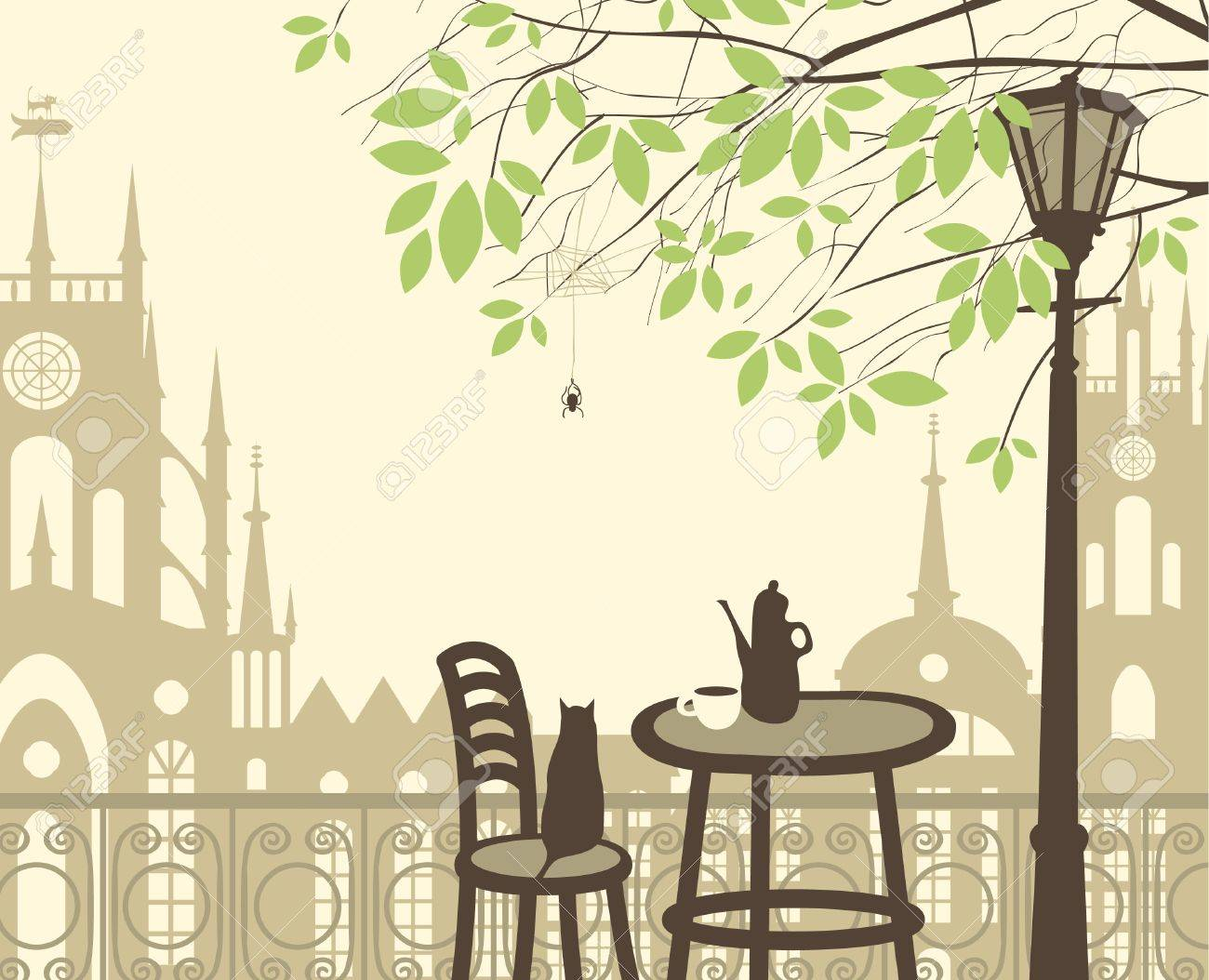 outdoor cafe in the old town with a table and a kettle cat spider - 18423495