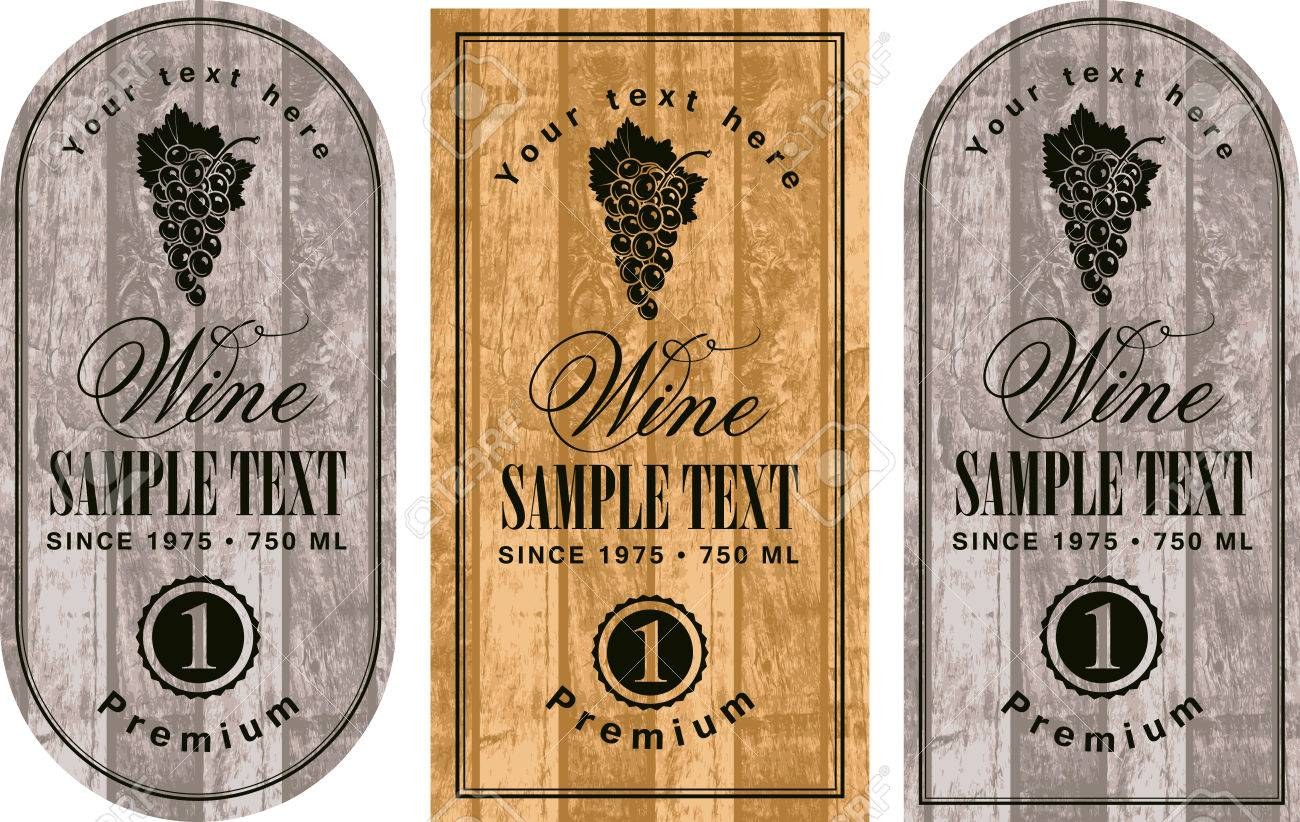 set of wine labels with grapes on the background of wooden boards - 50990720