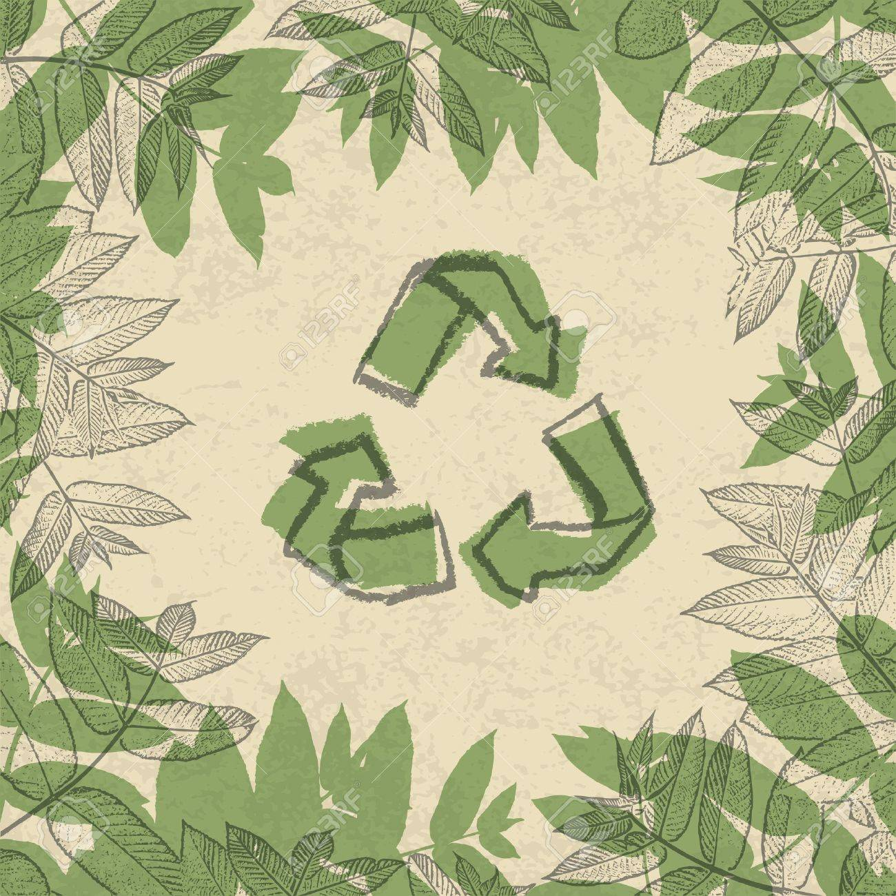 recycle symbol printed on reuse paper in frame of leaves