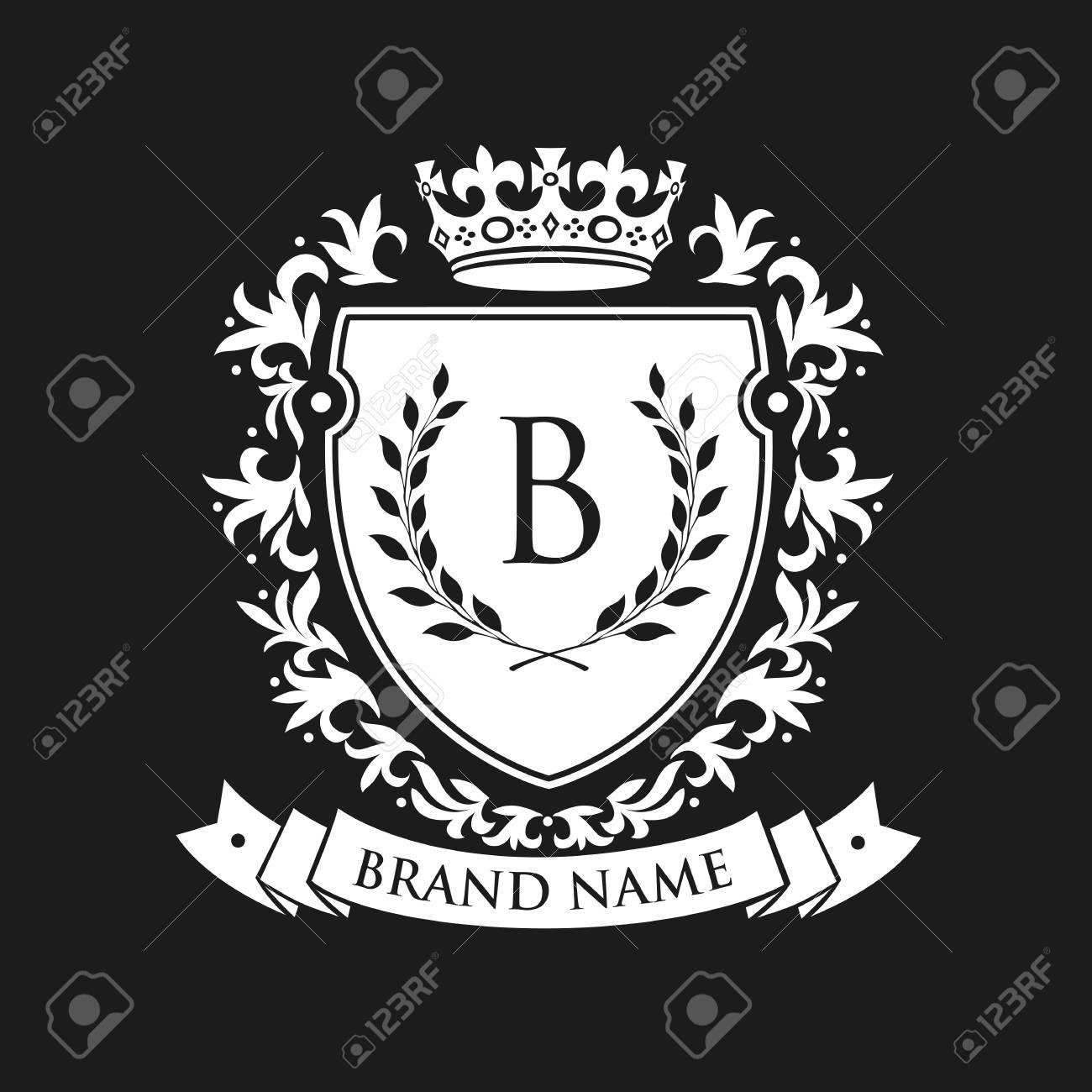 Heraldic emblem shield with crown and laurel wreath. Coat Arms Vintage Brand Crest Heraldic Emblem Shield. Vector illustration - 82116118